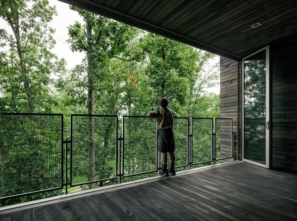 A terrace on the first level-Forest Treehouse Displaying Sustainable Architecture
