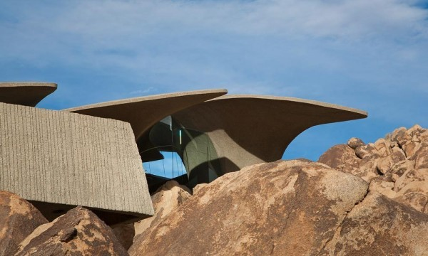 A view towards the concrete and glass facade-Organic Desert Residence - Architecture and Interior Design