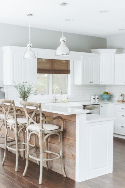 Beautiful white kitchen with island and bar stools- Eclectic Rustic Cottage Interior with Summer Beach Style Touches