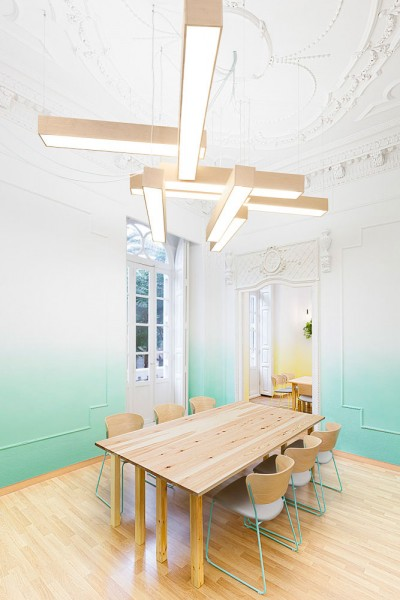 Contemporary classroom with wooden table and chairs