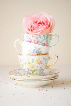 Creative idea for tea cups and a rose blossom at the top