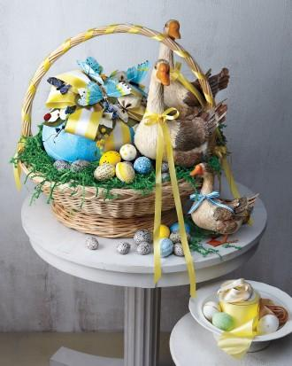 Easter basket full of duck figurines, butterflies and eggs
