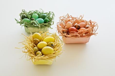 Easter basket full of monochromatic colored eggs