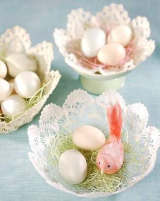 Easter cups with pale eggs and funny bird figurines