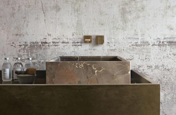 Eclectic bathroom sink inside industrial bathroom
