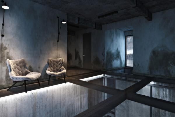 Exposed concrete walls and glass floor