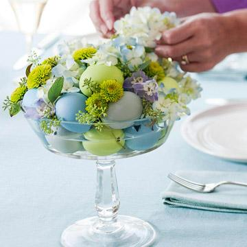 Glass vessel full of creative Easter table items