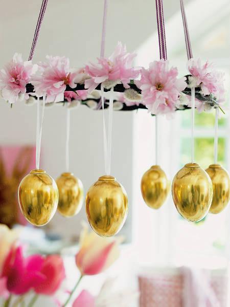 Golder Easter eggs hanging
