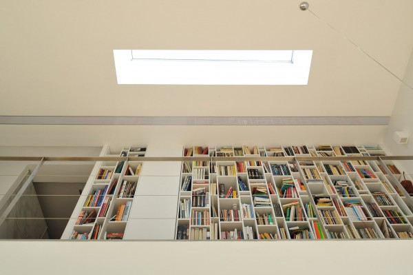 Home library located in the hallway on the second level-Contemporary House Architecture and Interior Design in Poland