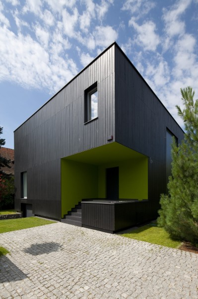 Main entrance and paved pathway to the house-Contemporary House Architecture and Interior Design in Poland