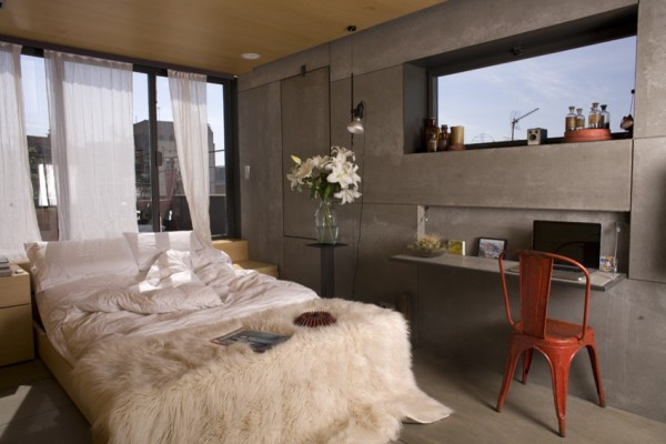 Mobile pulled out bed and windows behind it-Small Apartment Interior Design in Barcelona