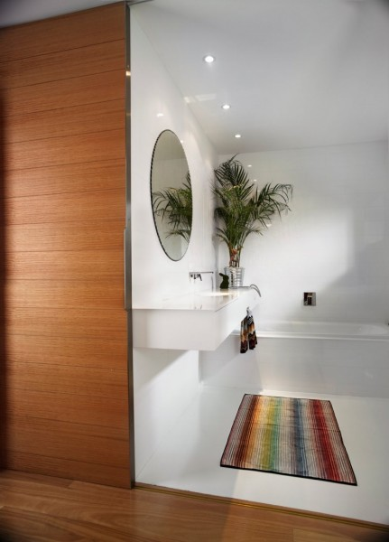 Nice clean white bathroom with colorful rug-Contemporary Luxurious Penthouse Interior Design in Australia