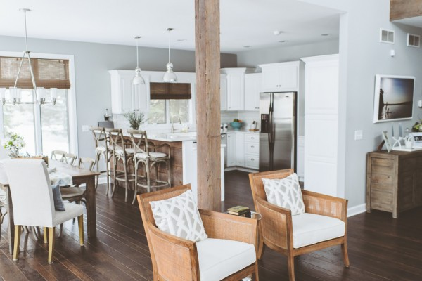 Open plan kitchen in white with wood accents- Eclectic Rustic Cottage Interior with Summer Beach Style Touches