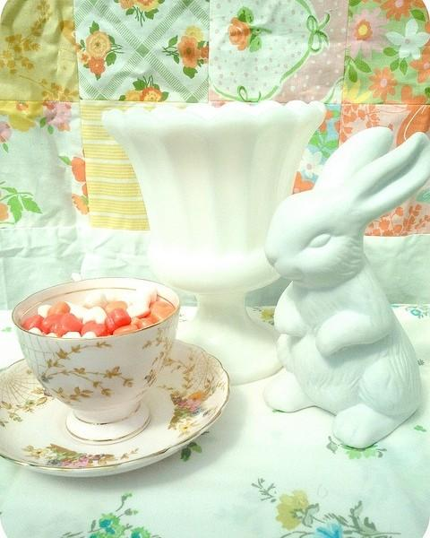 Porcelain bunny and tea cup full of treats