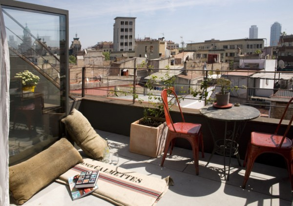 Rooftop terrace with a small coffee table for two-Small Apartment Interior Design in Barcelona