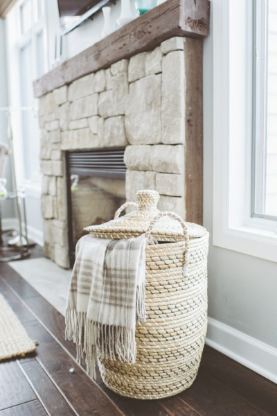 Rustic fireplace made of stone with wooden mantel- Eclectic Rustic Cottage Interior with Summer Beach Style Touches