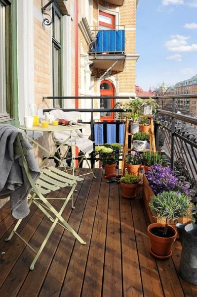 Scandianvian balcony with a lot of flowers-Trendy designs for outdoor home spaces