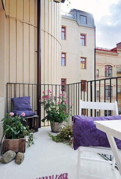 Scandiavian balcony with purple accents-Trendy designs for outdoor home spaces