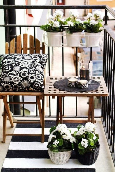 Scandinavian balcony with black and white accents-Trendy designs for outdoor home spaces