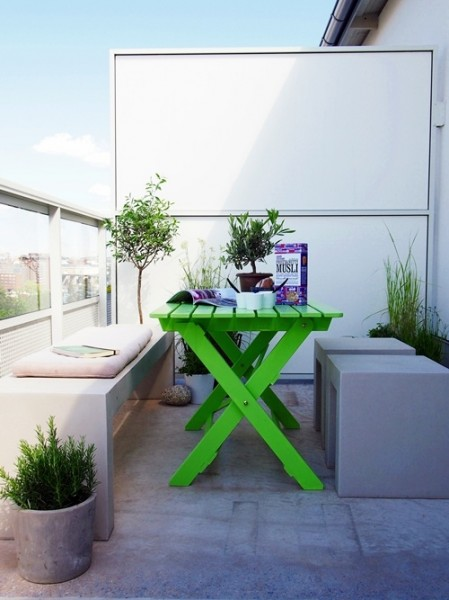 Scandinavian-balcony-with-green-table-Trendy designs for outdoor home spaces
