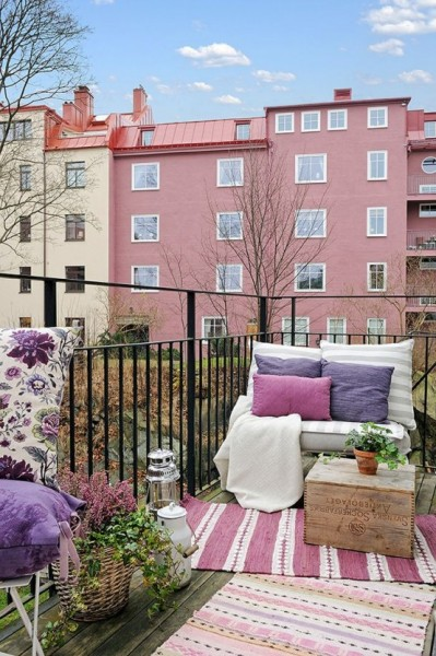 Scandinavian balcony with pink accents-Trendy designs for outdoor home spaces