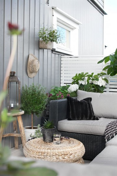 Scandinavian balcony with rattan furniture-Trendy designs for outdoor home spaces