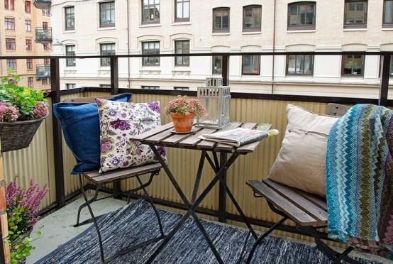 Scandinavian balcony with small table and chairs-Trendy designs for outdoor home spaces