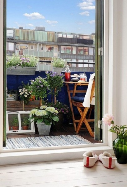 Scandinavian terrace decorated with flowers-Trendy designs for outdoor home spaces