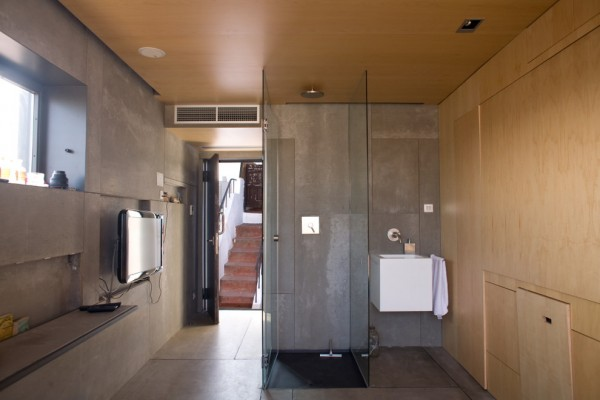 Shower glass cube and a modern sink besides-Small Apartment Interior Design in Barcelona