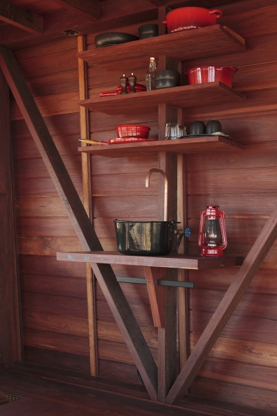 Simple copper sink and wooden shelves above it-Small Copper Tower Family Weekend Getaway in North Wales