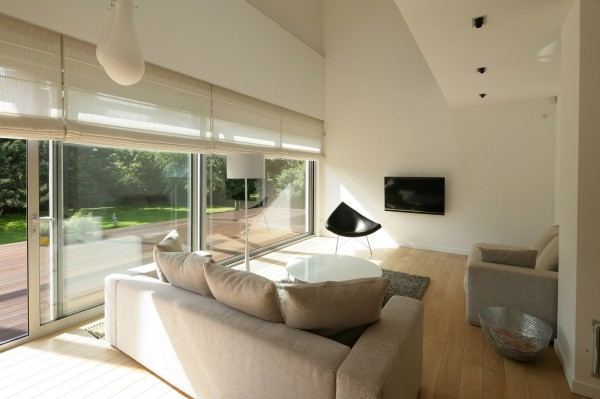 Small modern living room with double in height ceiling-Contemporary House Architecture and Interior Design in Poland