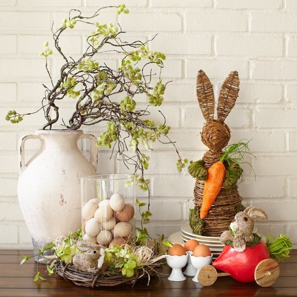 Stylish Easter bunny and porcelain vase full of branches