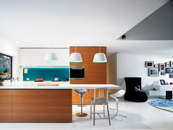 Stylish, clean kitchen in white with wood accents-Contemporary Luxurious Penthouse Interior Design in Australia