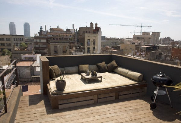 Sunny rooftop terrace with comfortable lounge couch-Small Apartment Interior Design in Barcelona
