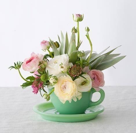 Tea cup full of fresh flowers