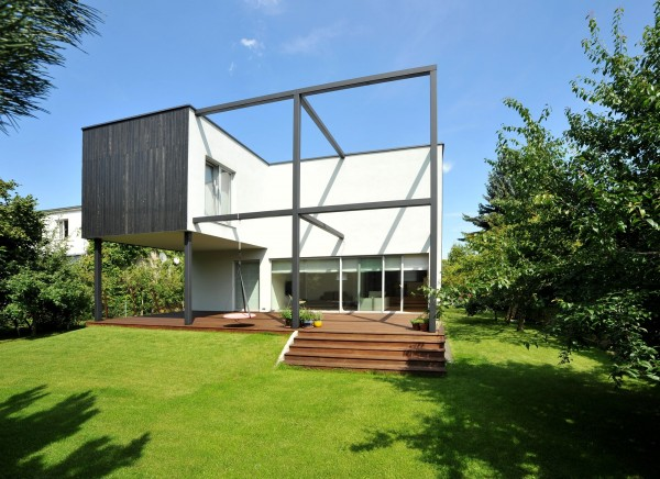 The back yard and the wooden deck-Contemporary House Architecture and Interior Design in Poland