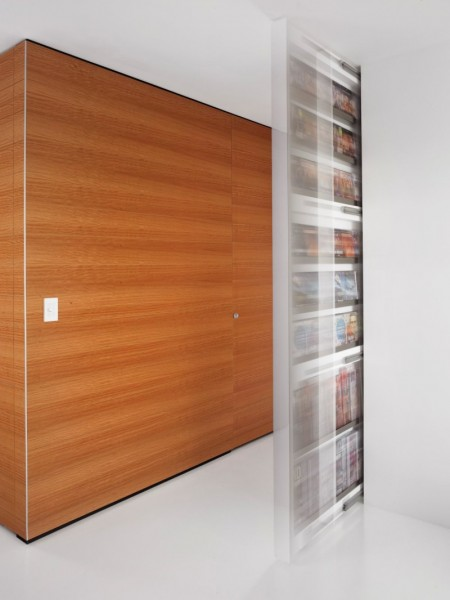 The hallway and its wooden panelling walls-Contemporary Luxurious Penthouse Interior Design in Australia