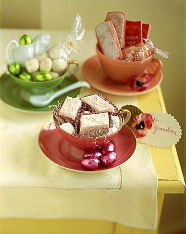 Three tea cup Easter baskets in green, orange and purple