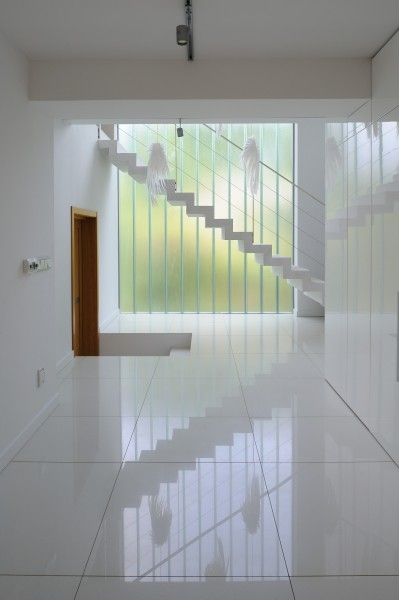 Very clean, modern and stylish hallway with white floor tiles-Contemporary House Architecture and Interior Design in Poland