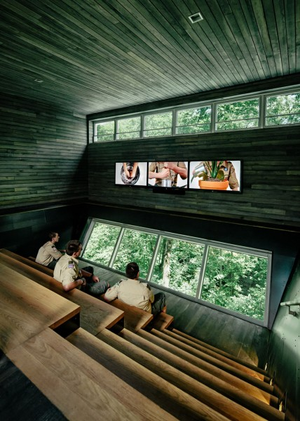Views towards the forest from inside the top room-Forest Treehouse Displaying Sustainable Architecture