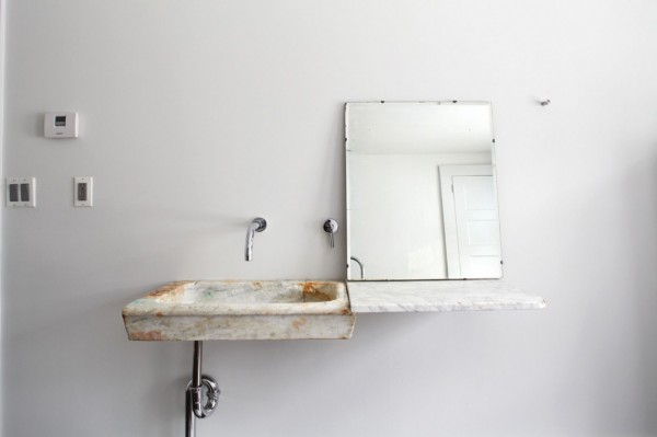 Vintage bathroom sink in a shabby chic farmhouse-charming interior design of a riverside house in New York.