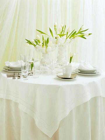 White Easter table with floral centerpieces