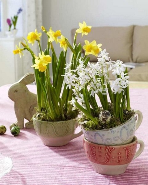 Yellow and white flowers in small vases– Inspiring Easter Decorating Ideas for a Memorable Holiday