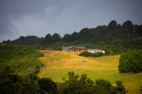 A distant view towards the house located on the hill-modern architecture residential design