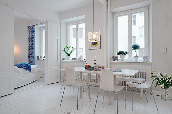 Airy dining room in white with a lot of natural light- Scandinavian Shabby Chic Apartment Interior in Gothenburg