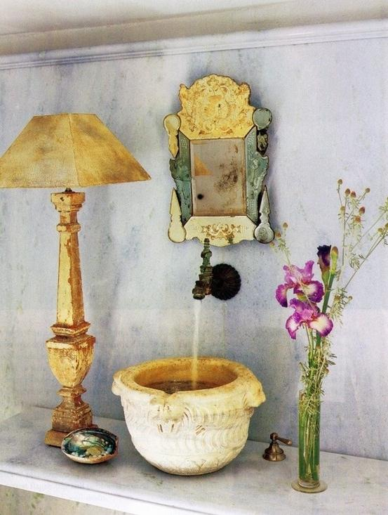 Bathroom decorating with fresh flowers and vintage items