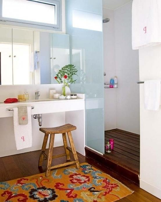 Bathroom decorating with small tree branches placed in a flower pot