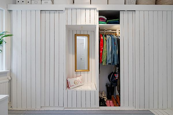 Clothes storage with shabby chic details- Scandinavian Shabby Chic Apartment Interior in Gothenburg
