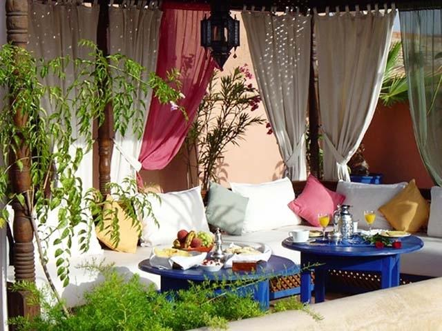 Comfortable sofas under a tent- Ideas for home outdoor spaces