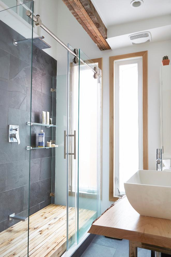 Contemporary small bathroom with glass sliding doors- inside a small eclectic house